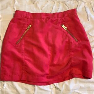 Hot pink suede mini skirt with gold zipper details